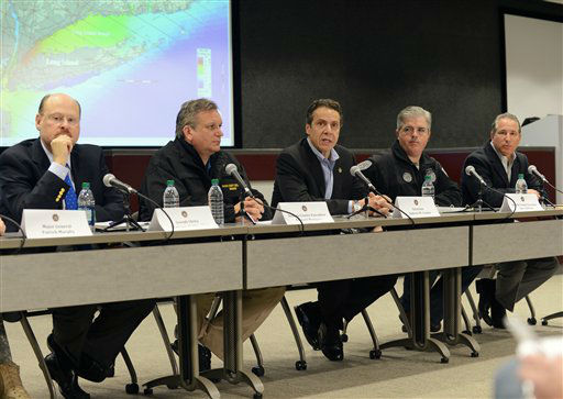 "<div class=""meta ""><span class=""caption-text "">In this photo provided by the governor's office, New York Gov. Andrew Cuomo, center, is flaked by, from left, MTA Chairman, Joseph Lhota; Nassau County Executive Edward Mangano; Cuomo; Suffolk County Executive Steve Bellone, and Director of Operations for New York State Howard Glaser, far right, as they give a storm updtate on the advancing Hurricane Sandy at the Nassau County Office of Emergency Management, Sunday, Oct. 28, 2012, in Bethpage, N.Y.  New York City's subways, buses and commuter trains, which make up the nation's largest transit system, are shutting down Sunday night in advance of the massive storm expected to hit the eastern third of the United States. (AP Photo/Office of NY Gov. Cuomo, Darren McGee) (AP Photo/ Darren McGee)</span></div>"