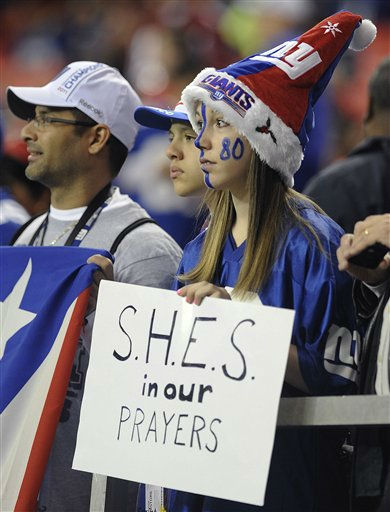 Makayla Ferfecki, of Kentucky, holds a sign honoring the victims of the shooting at Sandy Hook Elementary School in Newtown, Conn., before the first half of an NFL football game between the Atlanta Falcons and the New York Giants, Sunday, Dec. 16, 2012, in Atlanta. A gunman walked into the school Friday and opened fire, killing 26 people, including 20 children. &#40;AP Photo&#47;Mike Stewart&#41; <span class=meta>(AP Photo&#47; Mike Stewart)</span>