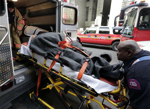 An injured passenger of a New Jersey ferry is loaded into an ambulance, in New York, Wednesday, Jan. 9, 2013. The Fire Department says at least 50 people were injured when the ferry struck a dock during rush hour. &#40;AP Photo&#47;Richard Drew&#41; <span class=meta>(AP Photo&#47; Richard Drew)</span>