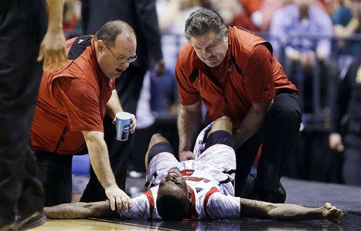Trainers check on Louisville guard Kevin Ware &#40;5&#41; after Ware injured his lower right leg during the first half of the Midwest Regional final against Duke in the NCAA college basketball tournament, Sunday, March 31, 2013, in Indianapolis. Ware left the court on a stretcher. &#40;AP Photo&#47;Michael Conroy&#41; <span class=meta>(AP Photo&#47; Michael Conroy)</span>