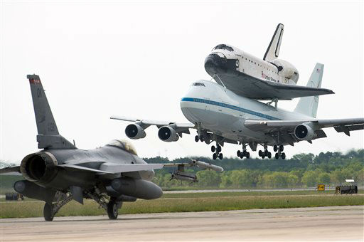 The space shuttle Endeavour, carried atop NASA&#39;s 747 Shuttle Carrier Aircraft, lands at Ellington Field past an aircraft from the Texas Air National Guard 147th Reconnaissance Wing on Wednesday, Sept. 19, 2012, in Houston. Endeavour stopped in Houston on its way from the Kennedy Space Center to the California Science Center in Los Angeles, where it will be placed on permanent display. &#40;AP Photo&#47;Houston Chronicle, Smiley N. Pool, Pool&#41; <span class=meta>(AP Photo&#47; Smiley N. Pool)</span>