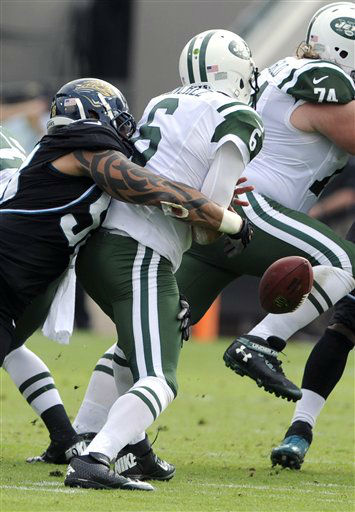 Jacksonville Jaguars defensive end Jason Babin, left,  sacks New York Jets quarterback Mark Sanchez &#40;6&#41; forcing a fumble during the first half of an NFL football game, Sunday, Dec. 9, 2012, in Jacksonville, Fla. &#40;AP Photo&#47;Stephen Morton&#41; <span class=meta>(AP Photo&#47; Stephen Morton)</span>