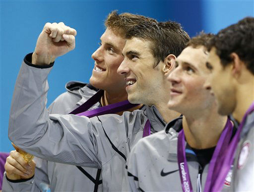 United States&#39; Conor Dwyer, left, Michael Phelps, center, Ryan Lochte, second right, and Ricky Berens, right, pose with their gold medals after their win in the men&#39;s 4 x 200-meter freestyle relay at the Aquatics Centre in the Olympic Park during the 2012 Summer Olympics in London, Tuesday, July 31, 2012. &#40;AP Photo&#47;Daniel Ochoa De Olza&#41; <span class=meta>(AP Photo&#47; Daniel Ochoa De Olza)</span>