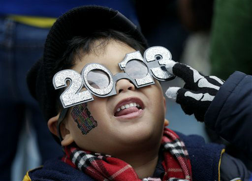 Benjamin Nadorf, 4, fools around with his new glasses while waiting for the New Year in Times Square in New York, Monday, Dec. 31, 2012.  One million people are expected to cram into the area for the countdown&#40;AP Photo&#47;Seth Wenig&#41; <span class=meta>(AP Photo&#47; Seth Wenig)</span>