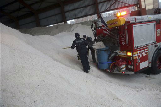 Firefighters load salt onto a container in the back of their truck at a Sanitation Department depot, Friday, Feb. 8, 2013 in New York. A storm poised to dump up to 3-feet of snow from New York City to Boston and beyond beginning Friday could be one for the record books, forecasters warned, as residents scurried to stock up on food and water and road crews readied salt and sand.  &#40;AP Photo&#47;Mary Altaffer&#41; <span class=meta>(Photo&#47;Mary Altaffer)</span>