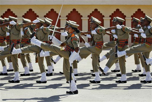 A female Indian Border Security Force &#40;BSF&#41; officer, center, leads a squad of her male and few female colleagues during their passing out ceremony in Bangalore, India, Friday, Jan. 25, 2013. BSF with a total strength of about 250,000 personnel including women is one of the world&#39;s largest border patrol forces established in 1965. &#40;AP Photo&#47;Aijaz Rahi&#41; <span class=meta>(AP Photo&#47; Aijaz Rahi)</span>