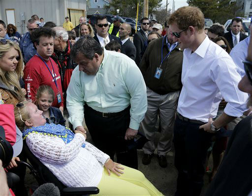 "<div class=""meta image-caption""><div class=""origin-logo origin-image ""><span></span></div><span class=""caption-text"">New Jersey Gov. Chris Christie, center, talks to a resident as Britain's Prince Harry, right, looks on while visiting the area hit by Superstorm Sandy, Tuesday, May 14, 2013, in Seaside Heights, N.J.  Prince Harry began a tour  of New Jersey?s storm-damaged coastline, inspecting dune construction, walking past destroyed homes and shaking hands with police and other emergency workers.  New Jersey sustained about $37 billion worth of damage from the storm. (AP Photo/Mel Evans, Pool) (AP Photo/ Mel Evans)</span></div>"