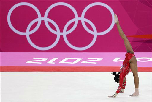 "<div class=""meta ""><span class=""caption-text "">U.S. gymnast Gabrielle Douglas performs on the floor during the Artistic Gymnastic women's team final at the 2012 Summer Olympics, Tuesday, July 31, 2012, in London. (AP Photo/Gregory Bull) (AP Photo/ Gregory Bull)</span></div>"