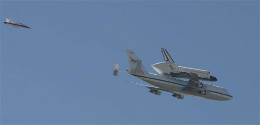 Space Shuttle Endeavour mounted on NASA's Shuttle Carrier Aircraft, flies above Huntington Beach, Calif. on Friday, Sept. 21, 2012. Endeavour is making a final trek across the country to the California Science Center in Los Angeles, where it will be permanently displayed. (AP Photo/Christine Cotter)