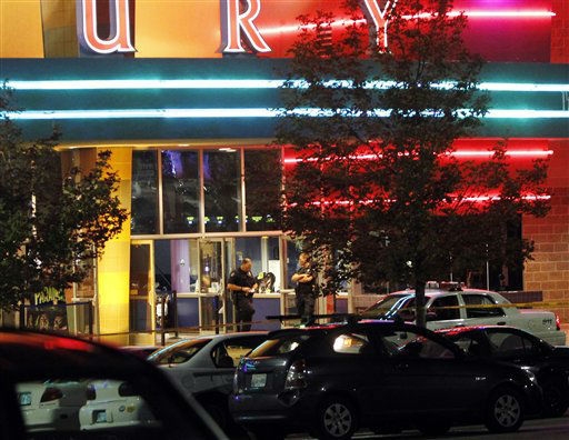 "<div class=""meta ""><span class=""caption-text "">Police are pictured outside of a  Century 16 movie theatre where as many as 14 people were killed and many injured at a shooting during the showing of a movie at the in Aurora, Colo., Friday, July 20, 2012. (AP Photo/Ed Andrieski) (AP Photo/ Ed Andrieski)</span></div>"