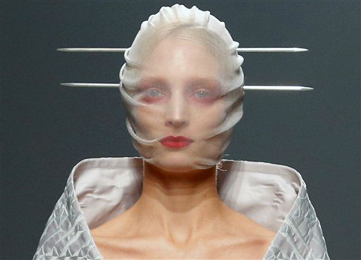 "<div class=""meta image-caption""><div class=""origin-logo origin-image ""><span></span></div><span class=""caption-text"">A model wears a creation by British fashion designer Gareth Pugh for the fashion house's Spring Summer 2013 ready to wear collection, during Fashion Week, in Paris, Wednesday, Sept. 26, 2012.(AP Photo/Jacques Brinon) (AP Photo/ Jacques Brinon)</span></div>"