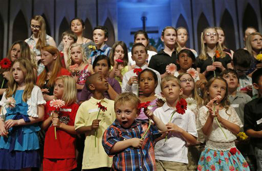 "<div class=""meta image-caption""><div class=""origin-logo origin-image ""><span></span></div><span class=""caption-text"">Four-year-old Keltin Marazzi, center, waits to perform with other Moore schoolchildren during a memorial service for those affected by the tornado at the First Baptist Church in Moore, Okla., Sunday, May 26, 2013. (AP Photo/Sue Ogrocki, Pool) (AP Photo/ Sue Ogrocki)</span></div>"