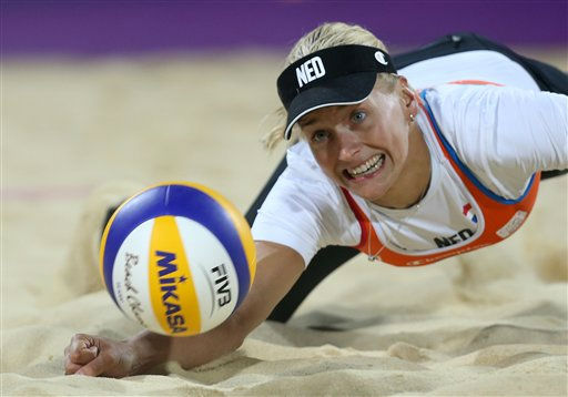 Marleen Van Iersel from Netherlands dives for a ball during the Beach Volleyball match against USA at the 2012 Summer Olympics, Saturday, Aug. 4, 2012, in London. &#40;AP Photo&#47;Petr David Josek&#41; <span class=meta>(AP Photo&#47; Petr David Josek)</span>