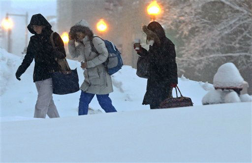 "<div class=""meta ""><span class=""caption-text "">Nurses walk to work before dawn outside Tufts Medical Center in Boston, Saturday, Feb. 9, 2013. The Boston area received about two feet of snow from a winter storm. (AP Photo/Charles Krupa) (AP Photo/ Charles Krupa)</span></div>"