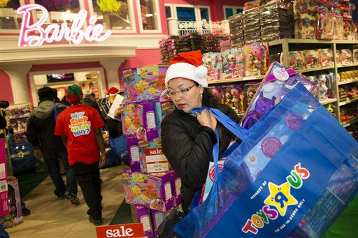 A shopper browses the aisles at the Times Square Toys-R-Us store after doors were opened to the public at 8 p.m. on Thursday, Nov. 22, 2012, in New York. While stores typically open in the wee hours of the morning on the day after Thanksgiving known as Black Friday, openings have crept earlier and earlier over the past few years. Now, stores from Wal-Mart to Toys R Us are opening their doors on Thanksgiving evening, hoping Americans will be willing to shop soon after they finish their pumpkin pie. &#40;AP Photo&#47;John Minchillo&#41; <span class=meta>(AP Photo&#47; John Minchillo)</span>