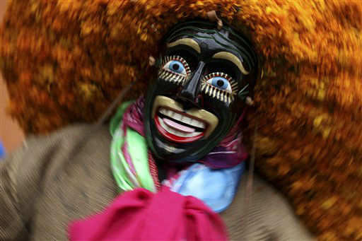 "<div class=""meta ""><span class=""caption-text "">A circus performer belonging to the ""Los Zoyacapoteros"", part of the ""Indigenous Laboratory of Acrobatics"" performs at the Takilhsukut park as part of the Cumbre Tajin 2013 music festival celebrations in Papantla, Mexico, Monday March 25, 2013. The Laboratory is a collaboration between circus performers and acrobats belonging to several indigenous communities from the Gulf state of Veracruz. (AP Photo/Felix Marquez) (AP Photo/ Felix Marquez)</span></div>"