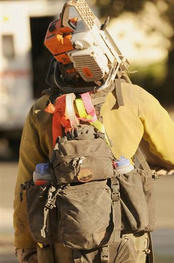 In this Saturday, June 22, 2013 photo released by the Prescott Fire Department, a member of the Granite Mountain Hot Shots carries his equipment while battling the Doce fire near Prescott, Ariz. On Sunday, June 30, 2013, a fast-moving wildfire killed 19 firefighters from the Prescott-based Granite Mountain Hot Shots after the blaze raced through the central Arizona town of Yarnell, about 85 miles northwest of Phoenix. &#40;AP Photo&#47;Prescott Fire Department, Wade Ward&#41; <span class=meta>(AP Photo&#47; Wade Ward)</span>