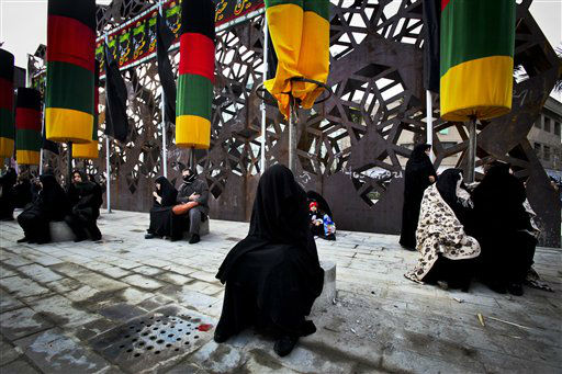 Iranian mourners attend a ceremony commemorating Arbaeen, the final day of the annual 40-day mourning period for the seventh century martyrdom of Imam Hussein, the grandson of Prophet Muhammad, in Tehran, Iran, Thursday, Jan. 3, 2012. &#40;AP Photo&#47;Vahid Salemi&#41; <span class=meta>(AP Photo&#47; Vahid Salemi)</span>
