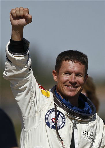 Felix Baumgartner, of Austria, pumps his fist to the crowd after successfully jumping from a space capsule lifted by a helium balloon at a height of just over 128,000 feet above the Earth&#39;s surface, Sunday, Oct. 14, 2012, in Roswell, N.M. Baumgartner came down safely in the eastern New Mexico desert minutes about nine minutes after jumping from his capsule 128,097 feet, or roughly 24 miles, above Earth &#40;AP Photo&#47;Ross D. Franklin&#41; <span class=meta>(AP Photo&#47; Ross Franklin)</span>