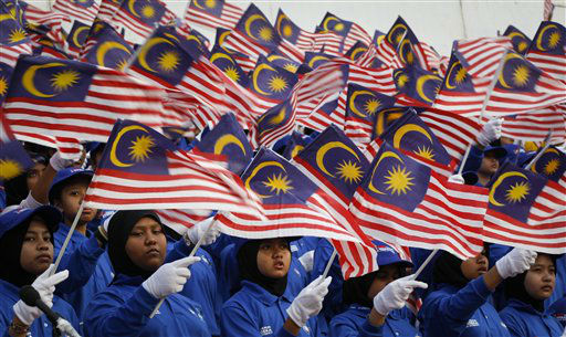 Malaysian students wave their national flags at rehearsal for Malaysia National Day celebrations at Independence Square in Kuala Lumpur, Malaysia, Wednesday, Aug. 29, 2012. The country will celebrate its 55th National Day on Aug. 31. &#40;AP Photo&#47;Vincent Thian&#41; <span class=meta>(AP Photo&#47; Vincent Thian)</span>
