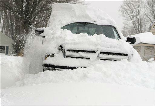 "<div class=""meta ""><span class=""caption-text "">Bob Seiler of East Windsor drives his truck without a plow through snow to clear a path for neighbors after a winter storm dumped in some areas 2 feet of snow in East Windsor, Conn., Saturday, Feb. 9, 2013.  (AP Photo/Jessica Hill) (AP Photo/ Jessica Hill)</span></div>"
