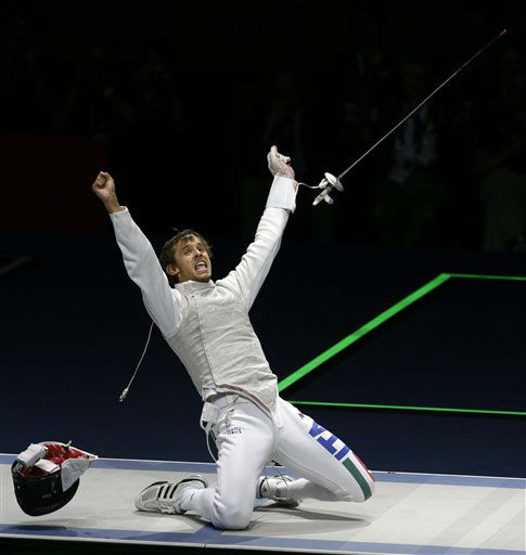 Andrea Baldini of Italy celebrates after his match against Yuki Ota of Japan in the gold medal match during the men&#39;s foil team fencing competition at the 2012 Summer Olympics, Sunday, Aug. 5, 2012, in London. Italy won the gold and Japan won the silver. &#40;AP Photo&#47;Andrew Medichini&#41; <span class=meta>(AP Photo&#47; Andrew Medichini)</span>
