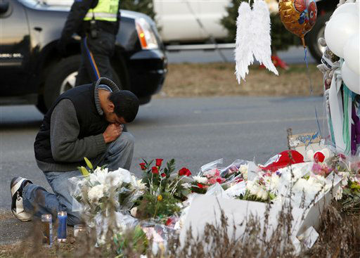 "<div class=""meta ""><span class=""caption-text "">A mourner pays his respects at a memorial for shooting victims near Sandy Hook Elementary School, Saturday, Dec. 15, 2012 in Newtown, Conn.  A gunman walked into Sandy Hook Elementary School in Newtown Friday and opened fire, killing 26 people, including 20 children. (AP Photo/Jason DeCrow) (AP Photo/ Jason DeCrow)</span></div>"