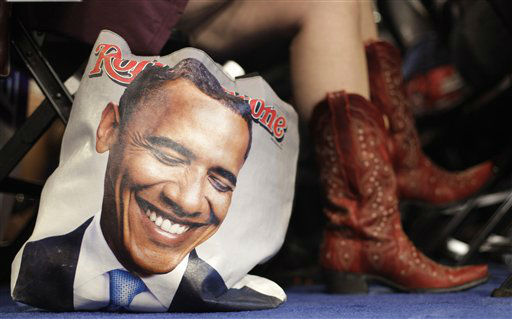 Colorado delegate Tracy Ducharme from Colorado Springs wears cowboy boots as she sit next to her bag showing President Barack Obama during the Democratic National Convention in Charlotte, N.C., on Tuesday, Sept. 4, 2012. &#40;AP Photo&#47;David Goldman&#41; <span class=meta>(AP Photo&#47; David Goldman)</span>