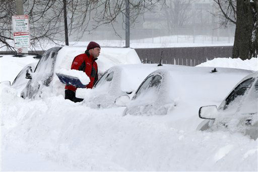 "<div class=""meta ""><span class=""caption-text "">A man shovels snow off his car on M street in the South Boston neighborhood of Boston Saturday, Feb. 9, 2013 in Boston. Boston was blanketed in up to 2 feet of snow, falling short of the city's record of 27.6 inches set in 2003. In some communities just outside the city, totals were higher, including 30 inches in Quincy and Framingham. (AP Photo/Gene J. Puskar) (AP Photo/ Gene J. Puskar)</span></div>"