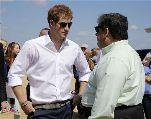 New Jersey Gov. Chris Christie, right, talks to Britain&#39;s Prince Harry while visiting the area hit by Superstorm Sandy, Tuesday, May 14, 2013, in Seaside Heights, N.J.  Prince Harry began a tour  of New Jersey?s storm-damaged coastline, inspecting dune construction, walking past destroyed homes and shaking hands with police and other emergency workers.  New Jersey sustained about &#36;37 billion worth of damage from the storm. &#40;AP Photo&#47;Mel Evans, Pool&#41; <span class=meta>(AP Photo&#47; Mel Evans)</span>