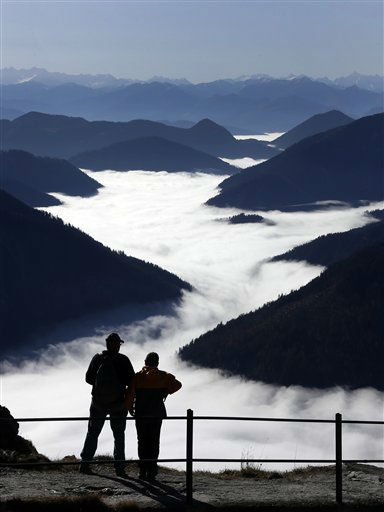 Hikers enjoy the view over the mist in the valleys of the Alps from the top of Wendelstein mountain &#40;1,838 meters&#41; near Bayrischzell, southern Germany, on Thursday, Oct. 25, 2012. &#40;AP Photo&#47;Matthias Schrader&#41; <span class=meta>(AP Photo&#47; Matthias Schrader)</span>