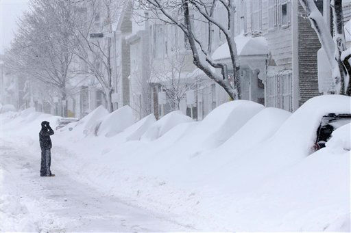 "<div class=""meta ""><span class=""caption-text "">A man talks on the phone as he looks at a row of cars buried in snow on Third Street in the South Boston neighborhood of Boston Saturday, Feb. 9, 2013. (AP Photo/Gene J. Puskar)</span></div>"