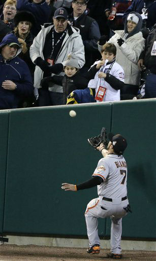 San Francisco Giants right fielder Gregor Blanco catches a foul ball hit by Detroit Tigers shortstop Jhonny Peralta &#40;27&#41; during the ninth inning of Game 3 of baseball&#39;s World Series Saturday, Oct. 27, 2012, in Detroit. &#40;AP Photo&#47;Charlie Riedel&#41; <span class=meta>(AP Photo&#47; Charlie Riedel)</span>
