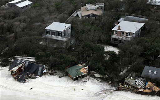 Badly damaged seaside homes are shown in this aerial photo, Wednesday, Oct. 31, 2012 along Long Island&#39;s south shore following superstorm Sandy which struck New York state Monday and Tuesday. Sandy, the storm that made landfall Monday, caused multiple fatalities, halted mass transit and cut power to more than 6 million homes and businesses. &#40;AP Photo&#47;Mark Lennihan&#41; <span class=meta>(AP Photo&#47; Mark Lennihan)</span>