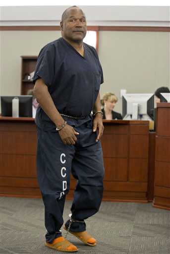 O.J. Simpson returns to the witness stand to testify after a break during an evidentiary hearing in Clark County District Court, Wednesday, May 15, 2013 in Las Vegas. Simpson, who is currently serving a nine to 33-year sentence in state prison as a result of his October 2008 conviction for armed robbery and kidnapping charges, is using a writ of habeas corpus, to seek a new trial, claiming he had such bad representation that his conviction should be reversed. &#40;AP Photo&#47;Julie Jacobson, Pool&#41; <span class=meta>(AP Photo&#47; Julie Jacobson)</span>