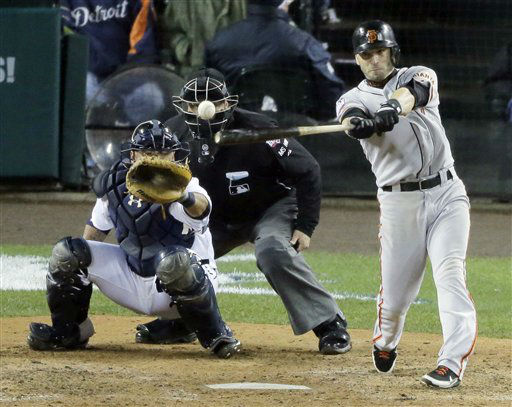 San Francisco Giants second baseman Marco Scutaro hits an RBI single during the 10th inning of Game 4 of baseball&#39;s World Series against the Detroit Tigers Sunday, Oct. 28, 2012, in Detroit. &#40;AP Photo&#47;Charlie Riedel&#41; <span class=meta>(AP Photo&#47; Charlie Riedel)</span>