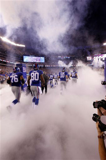 "<div class=""meta image-caption""><div class=""origin-logo origin-image ""><span></span></div><span class=""caption-text"">New York Giants wide receiver Victor Cruz (80) runs onto the field with teammates before an NFL football game against the Dallas Cowboys Wednesday, Sept. 5, 2012, in East Rutherford, N.J. (AP Photo/Julio Cortez) (AP Photo/ Julio Cortez)</span></div>"