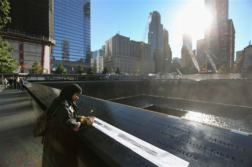 "<div class=""meta image-caption""><div class=""origin-logo origin-image ""><span></span></div><span class=""caption-text"">Khudeza Begum traces the name of her slain nephew at ceremonies for the eleventh anniversary of the terrorist attacks on the World Trade Center, Tuesday.  Sept. 11, 2012 in New York. Begum, who is from Bangladesh, lost her nephew Nural Miah and his wife Shakila Yasmin, two of the many Muslims who also died the 9/11 attacks. New York City is observing the eleventh anniversary of the Sept. 11. Attacks.  (AP Photo/Getty Imagers, John Moore, Pool) (AP Photo/ John Moore)</span></div>"