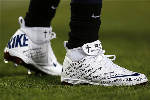 "<div class=""meta ""><span class=""caption-text "">Tennessee Titans running back Chris Johnson wears a pair of shoes with the names of the victims of the Sandy Hook Elementary School shootings in Newtown, Conn., during warmups before an NFL football game against the New York Jets, Monday, Dec. 17, 2012, in Nashville, Tenn. (AP Photo/Joe Howell) (AP Photo/ Joe Howell)</span></div>"