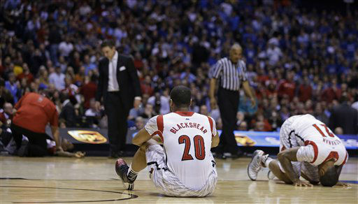 Louisville&#39;s Wayne Blackshear &#40;20&#41; and Chane Behanan &#40;21&#41; react to Kevin Ware&#39;s injury during the first half of the Midwest Regional final in the NCAA college basketball tournament, Sunday, March 31, 2013, in Indianapolis. &#40;AP Photo&#47;Darron Cummings&#41; <span class=meta>(AP Photo&#47; Darron Cummings)</span>