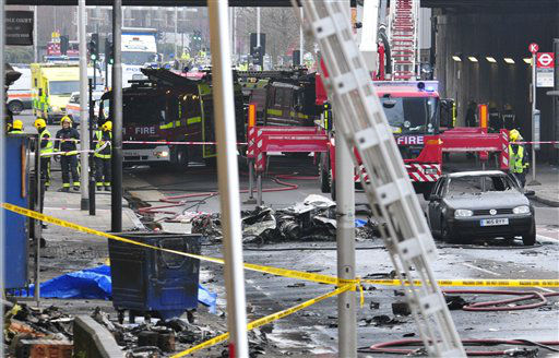 "<div class=""meta image-caption""><div class=""origin-logo origin-image ""><span></span></div><span class=""caption-text"">Debris lies on the ground after a helicopter crashed into a construction crane on top of St George's Wharf tower building, in London, Wednesday Jan. 16, 2013. Police say two people were killed when a helicopter crashed during rush hour in central London after apparently hitting a construction crane on top of a building. (AP Photo/Vince Pol) (AP Photo/ Vince Pol)</span></div>"