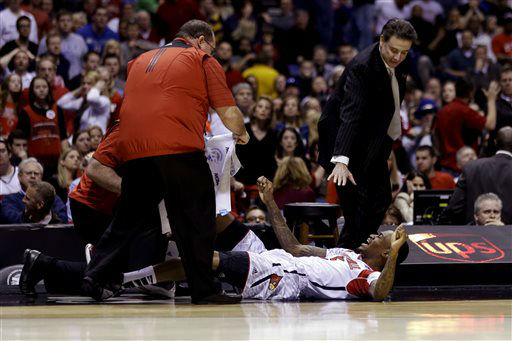 "<div class=""meta ""><span class=""caption-text "">Louisville head coach Rick Pitino and trainers tend to injured guard Kevin Ware during the first half of the Midwest Regional final in the NCAA college basketball tournament against Duke, Sunday, March 31, 2013, in Indianapolis. Ware badly injured his lower right leg and had to be taken off the court on a stretcher. (AP Photo/Darron Cummings) (AP Photo/ Darron Cummings)</span></div>"