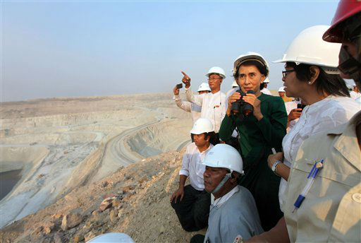 Myanmar&#39;s opposition leader Aung San Suu Kyi uses binoculars to look at the Letpadaung copper mine project during a visit to Myanmar Yang Tse Copper Limited in Monywa, 760 kilometers &#40;450 miles&#41; north of Yangon, central Myanmar, Thursday, March 14, 2013. In talks with villagers, Suu Kyi failed to persuade her listeners to agree with the conclusions of an official panel she headed that the national interest was best served by allowing continued operation of the Letpadaung copper mine, to encourage foreign investors to help the sagging economy.  &#40;AP Photo&#47;Khin Maung Win&#41; <span class=meta>(AP Photo&#47; Khin Maung Win)</span>