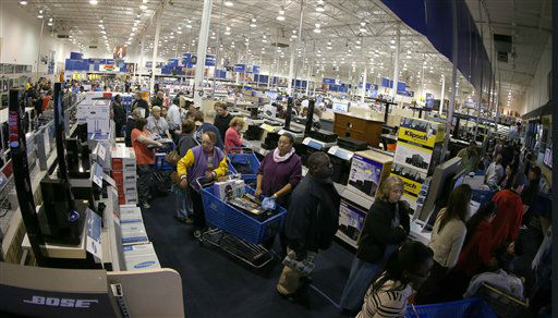 "Long lines of customers snake though the aisles waiting to check out, of the Best Buy store in Tyler, Texas, after it opened at midnight. Sheriff deputies contolled entry and only 1300 people at a time were allowed in to the store marking the beginning of ""Black Friday"" with ""door buster"" special deals, on November 23, 2012."