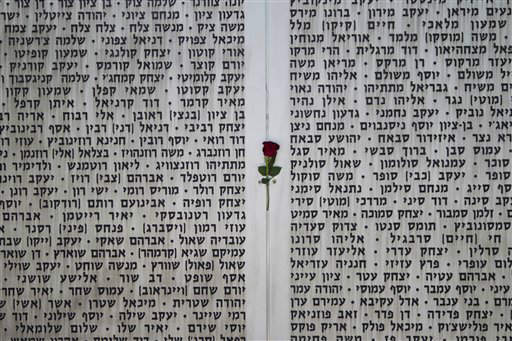 A rose hangs on the wall of names at the Armored Corps memorial for fallen soldiers before a ceremony marking the annual Memorial Day for soldiers and civilians killed in more than a century of conflict between Jews and Arabs, in Latrun near Jerusalem, Israel, Monday, April, 15,  2013. Israel says 23,085 security personnel have been killed since 1860, when Jews began moving back to the area. &#40;AP Photo&#47;Ariel Schalit&#41; <span class=meta>(AP Photo&#47; Ariel Schalit)</span>