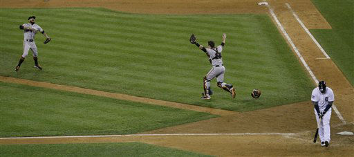 San Francisco Giants&#39; Sergio Romo and Buster Posey celebrate after the Giants defeated the Detroit Tigers4-3, in Game 4 of baseball&#39;s World Series Monday, Oct. 29, 2012, in Detroit. Detroit Tigers&#39; Miguel Cabrera walks away after striking out for the final out. &#40;AP Photo&#47;Paul Sancya &#41; <span class=meta>(AP Photo&#47; Paul Sancya)</span>