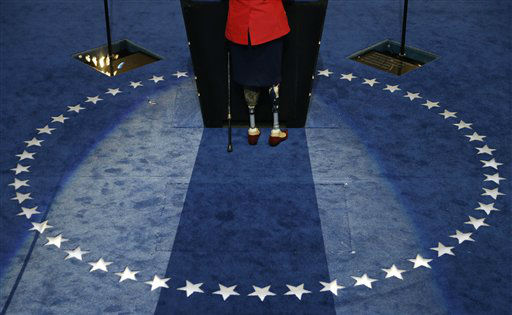 Former Assistant Secretary, U.S. Department of Veterans Affairs Tammy Duckworth stand at the podium as she speaks to delegates at the Democratic National Convention in Charlotte, N.C., on Tuesday, Sept. 4, 2012. &#40;AP Photo&#47;Charlie Neibergall&#41; <span class=meta>(AP Photo&#47; Charlie Neibergall)</span>