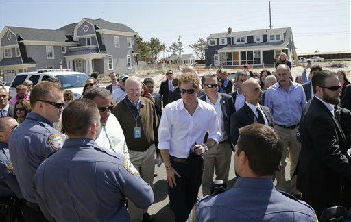 "<div class=""meta image-caption""><div class=""origin-logo origin-image ""><span></span></div><span class=""caption-text"">Britain's Prince Harry, center, talks to people during a visit an area hit by Superstorm Sandy, Tuesday, May 14, 2013, in Seaside Heights, N.J. New Jersey sustained about $37 billion worth of damage from the storm. (AP Photo/Mel Evans, Pool) (AP Photo/ Mel Evans)</span></div>"