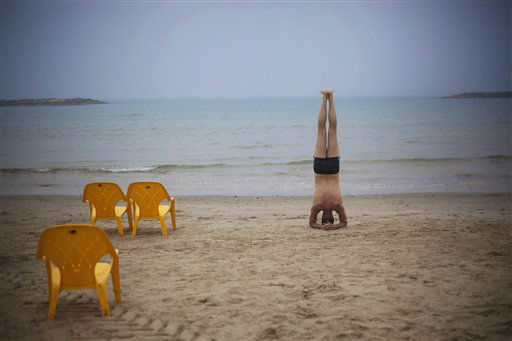 "<div class=""meta ""><span class=""caption-text "">A man exercises moments before swimming in the Mediterranean sea in Tel Aviv, Israel, Wednesday, Feb. 27, 2013. (AP Photo/Ariel Schalit)</span></div>"