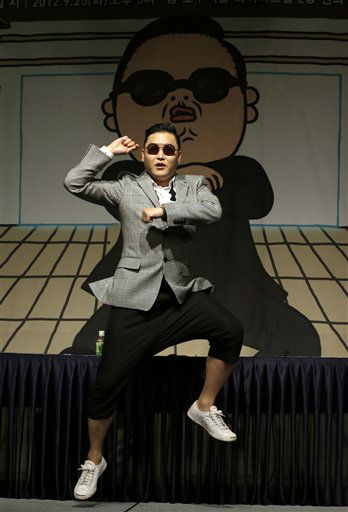 South Korean rapper PSY, who sings the popular &#34;Gangnam Style&#34; song, dances after his press conference in Seoul, South Korea, Tuesday, Sept. 25, 2012. &#40;AP Photo&#47;Lee Jin-man&#41; <span class=meta>(AP Photo&#47; Lee Jin-man)</span>